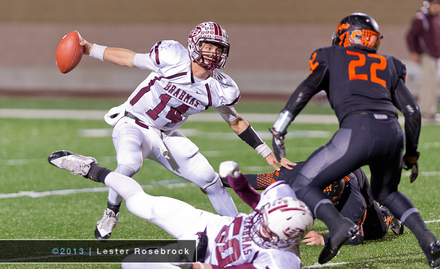 Grant Aschenbeck (East Bernard Brahmas) attempts to elude Alex Coronado (Refugio Bobcats) during the Texas UIL 2A Quarterfinal football game in San Antonio. Refugio went on to win the game 40-30 and moves on to play Waskom in the Semi-finals.