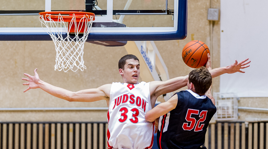 David Wacker (Judson Rockets) tries to block a shot by Braeden Bernstein (Churchill Chargers) during the UIL 5A Regional Quarter Finals at UTSA. Judson won the game 54-34 and moves on to play Edinburg North in the Regional Semi-Finals.  Click here for more photos