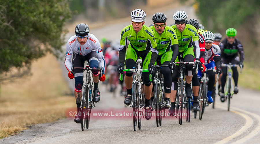 Racers ride up Hueco Springs Rd. during the Tour of New Braunfels bike race.  Click here to order images.
