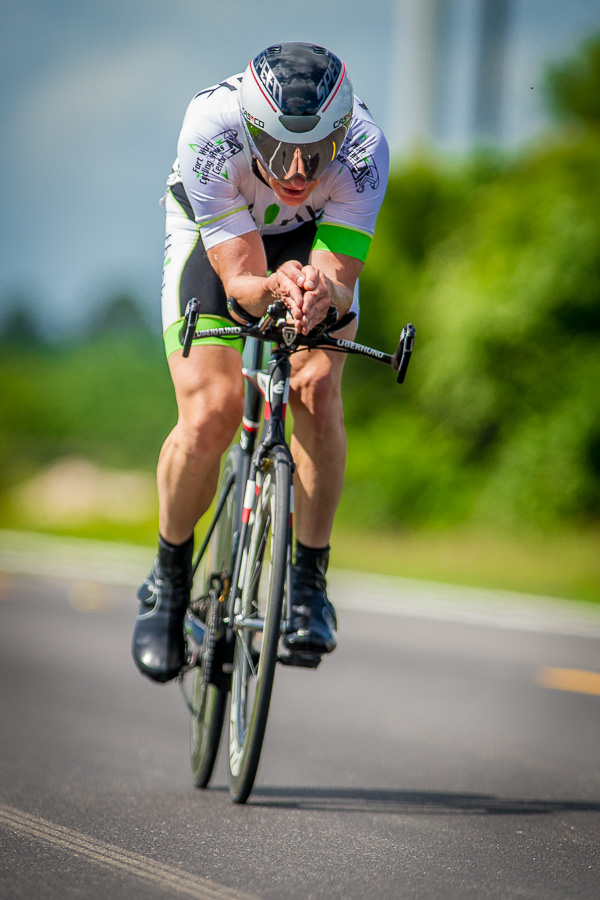 The time trial is a race of one rider vs the clock. There is no drafting or assistance from other cyclists, if you get a flat then your day is over. Every piece of the bike is scrutinized for optimal performance to slice through the wind. Even the clothes are carefully chosen, a flapping jersey or poorly pinned number (like the photo here) acts like a parachute and slows you down. Click here to purchase photographs.