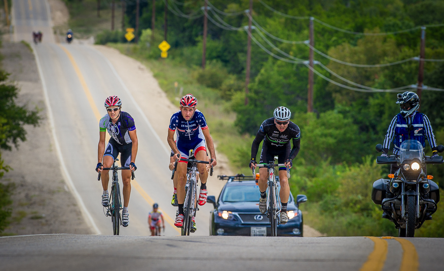 Racers climb a grueling hill during the Texas State Road Championships held at Ft. Hood.  The race was won by Ryan Wohlrabe of Bicycle Heaven (right).