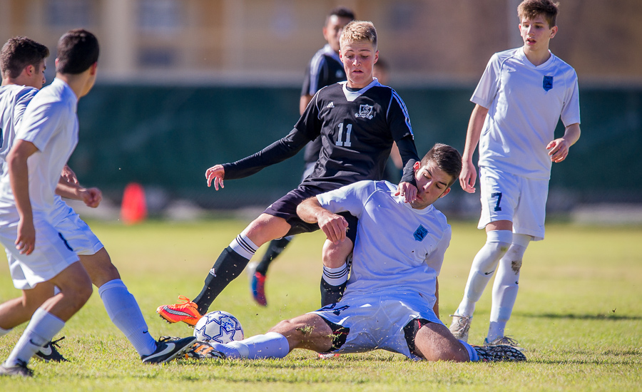 Johnson Jaguar Santiago Macias attempts to steal the ball from Cibolo Steele Knights during a game.