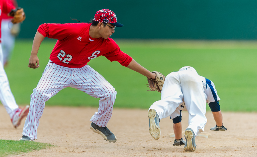 Drake Sevenstar with the Stilwell Indians (Oklahoma) nabs a Central Catholic runner before he reaches second base.